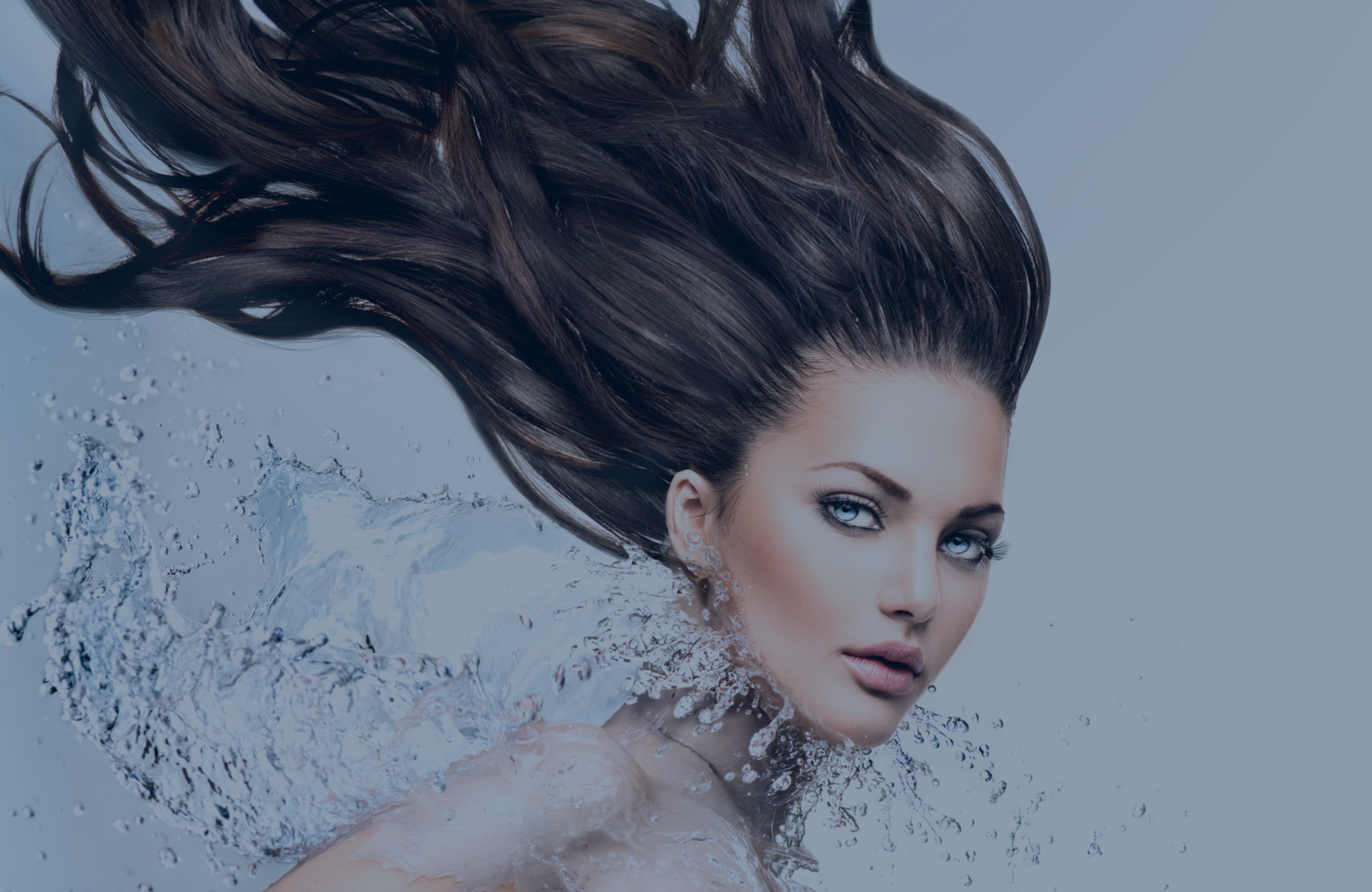 Skin Renewal Marco hair header featuring brunette hair moving through the air with water splashing on her neck